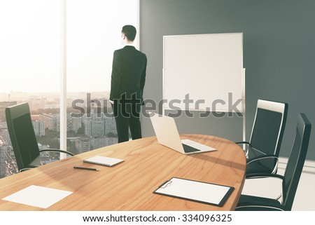 Blank board in conference room with businessman looking through the window, mock up 3D Render - stock photo