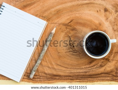 Blank book and coffee cup on old wood background