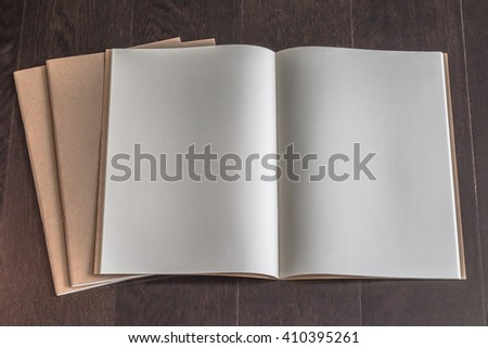 Blank book catalog magazines brochure open note page template recycle brown paper texture, dark color wood table/ wooden floor background: Eco friendly empty note book page on timber backdrop for text - stock photo