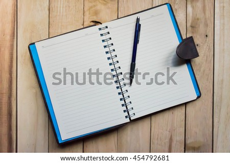 Blank book cover on textured wood background. Copy space.