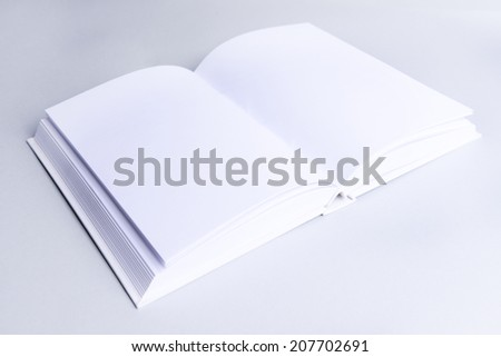 Blank book on light gray background - stock photo