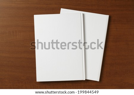 Blank Book on wooden table - stock photo