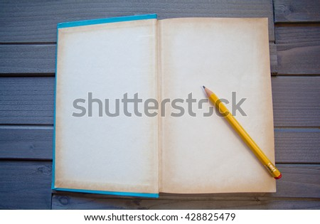 Blank Book or Diary Template on wood - stock photo