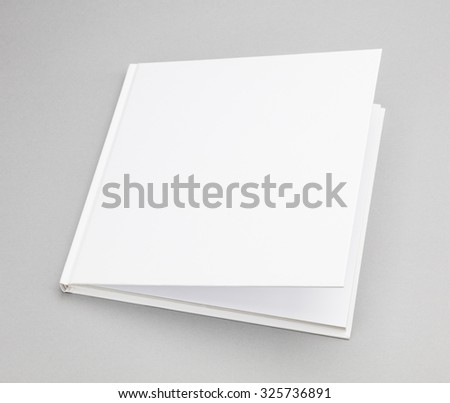 Blank book with ajar white cover - stock photo
