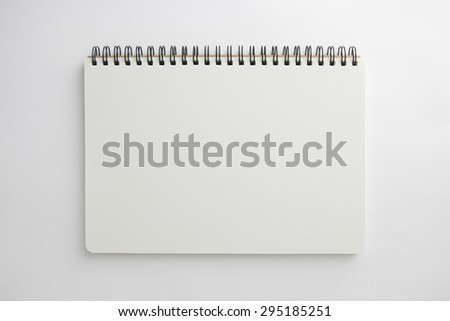 Blank book with soft shadows isolated on white.