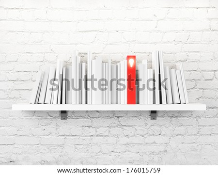 blank books on a shelf and one with idea cover - stock photo