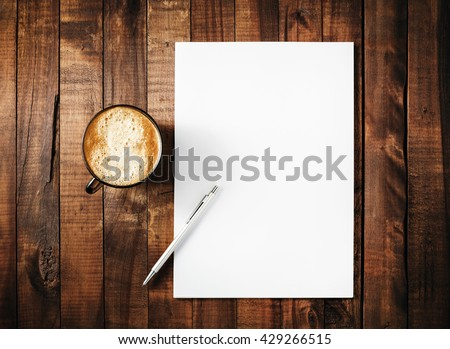Blank branding template on vintage wooden table background. Letterhead, coffee cup and pen. Blank stationery. Mock-up for branding identity for design portfolios. Top view. - stock photo