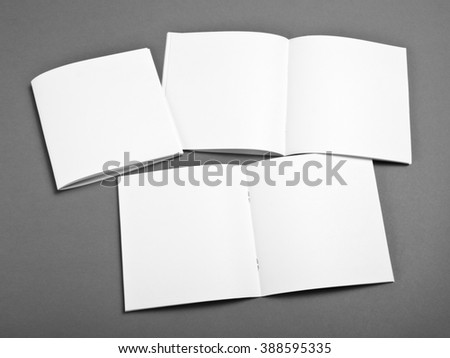 Blank brochure on grey background - stock photo