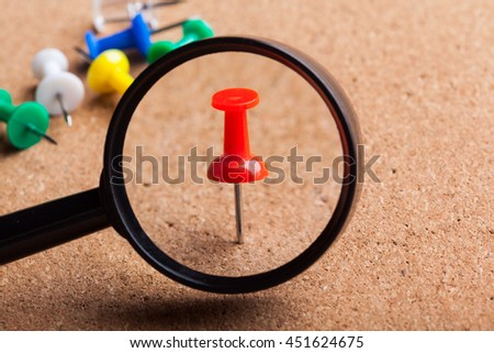 blank brown board and a magnifying glass - stock photo