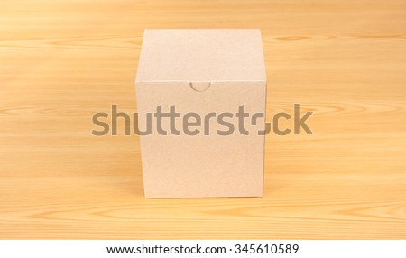 Blank Brown Paper Box  mock up on wood table