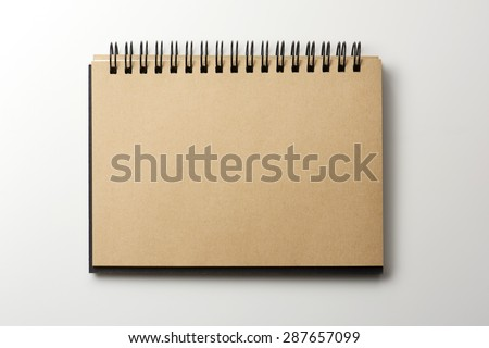 Blank brown paper scrap book isolated on natural white background. - stock photo