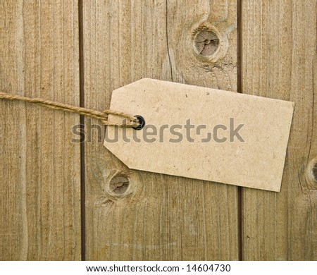 Blank Brown Price Tag On Wooden Background - stock photo