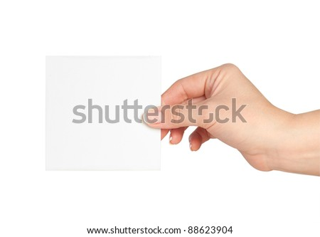 Blank business card in a hand isolated on white