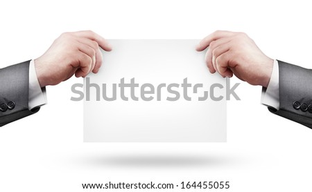 Blank business card in a hand isolated on white background High resolution  - stock photo