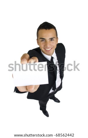 Blank business card in the hand of smiling business man, wide angle, isolated - stock photo