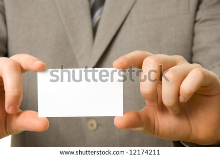 Blank business card in the hands of a businessman