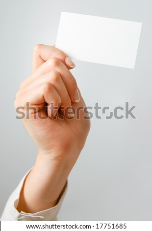 Blank business card in woman's hands - place your own text on it. - stock photo