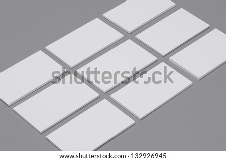 Blank Business Card isolated on grey background - stock photo