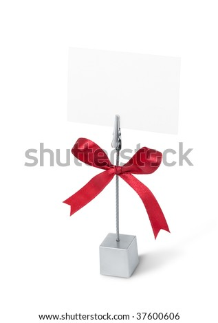 blank business card on holder against white background - stock photo