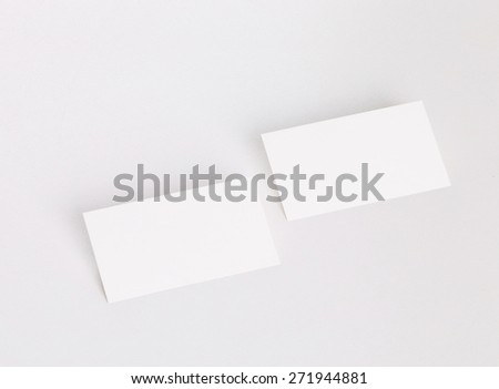 Blank business card on white background with soft shadows - stock photo