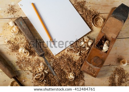Blank business card on wooden table for carpenter tools with sawdust top view. Copy space. - stock photo