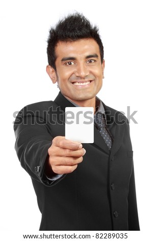 Blank business card presented by a businessman over white - stock photo