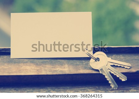 Blank business card with house figure. Real Estate Concept. Top view. - stock photo