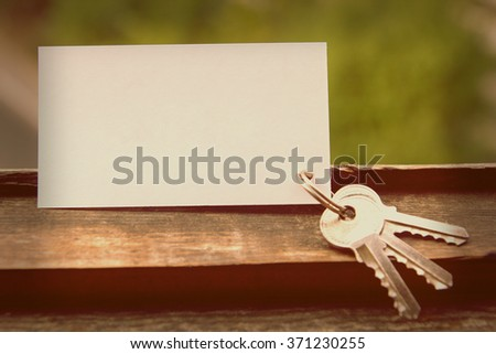 Blank business card with house figure. Real Estate Concept. Top view. Toned photo, instagram filter. - stock photo