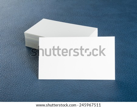 blank business cards on blue leather background, identity design, corporate templates, company style - stock photo