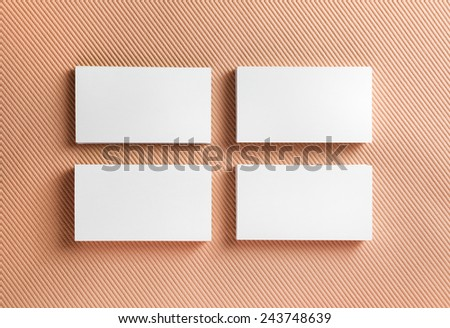Blank business cards on color background. Top view. - stock photo
