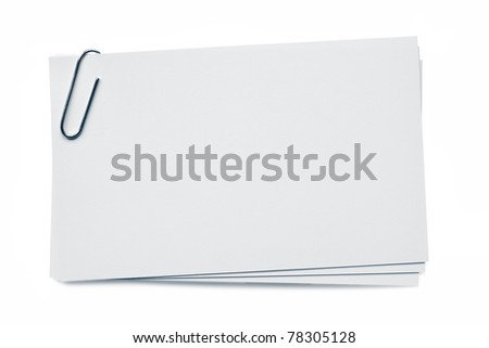 Blank business cards, with paperclip.  Isolated on white.  Clipping path included.