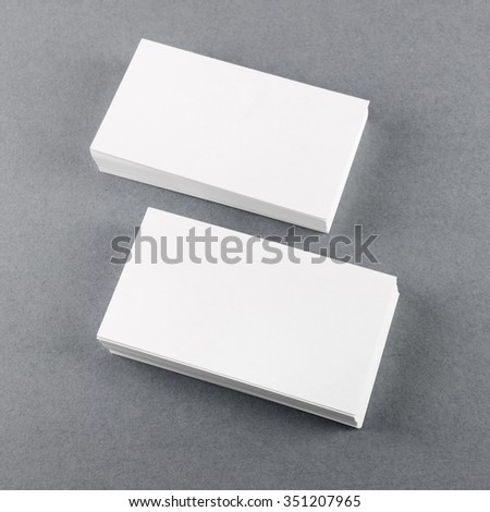 Blank business cards with soft shadows on gray background. Template for ID. Top view. - stock photo