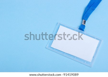 blank business plastic badge with blue neck strap and selective focus copy space - stock photo