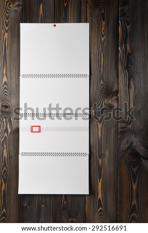 Blank calendar on wooden background - stock photo