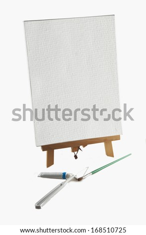 Blank canvas and instruments for painter over white background - stock photo