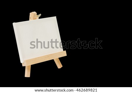 Blank canvas on easel for painting, Black background