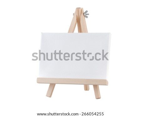 Blank canvas on wooden stand isolated on white background - stock photo