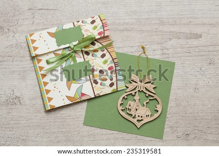 blank card and colorful envelope with Christmas tree decoration on the wooden background - stock photo
