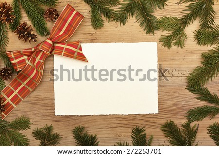 Blank card, fir twigs and ribbon, on wood - stock photo