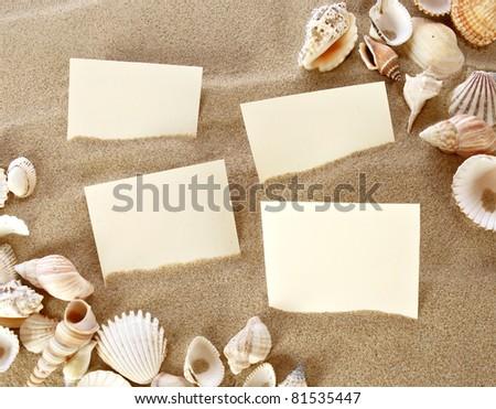 Blank card in beach sand - stock photo
