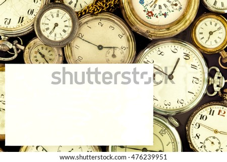 Blank card on a background of vintage pocket watch collection.
