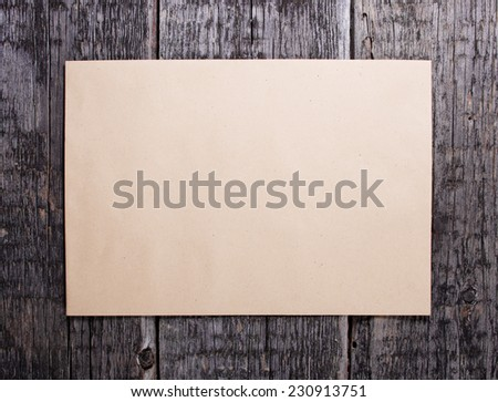 Blank card  on old wooden background  - stock photo