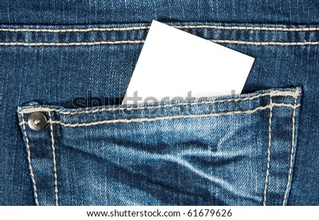 Blank card with copy space in a pocket of blue jeans. - stock photo