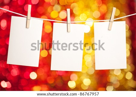 Blank card with copyspace on Christmas lights background - stock photo