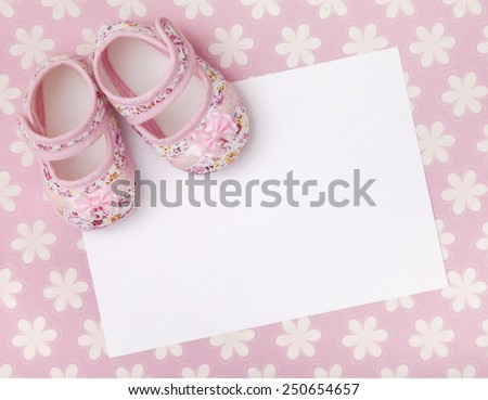 Blank Card With Pink Baby Girl Shoes On A Pastel Pink Floral Background.