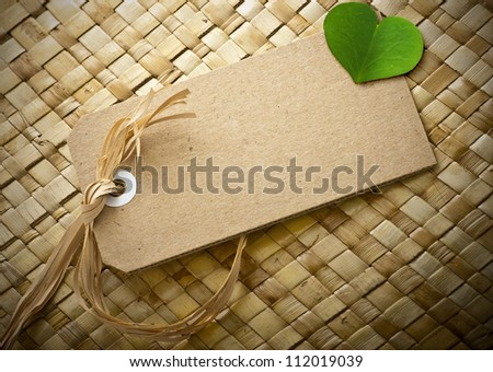 blank cardboard label with a clover leaf onto it, the is room for text, natural background - stock photo