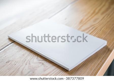 Blank catalog, magazines,book mock up on wood background - stock photo