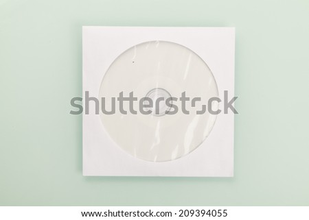 Blank CD or DVD on gray background.