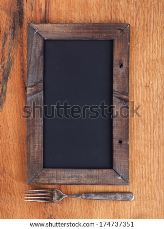 Blank chalkboard sign with fork - stock photo