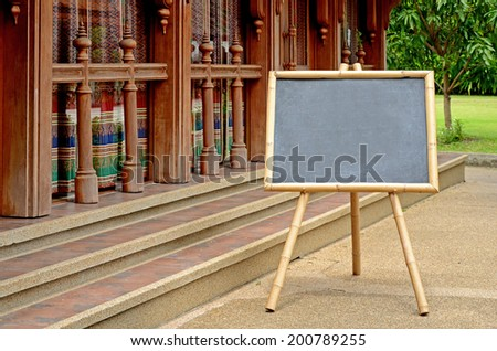 Blank Chalkboard with Bamboo wood Stand Outdoor. - stock photo